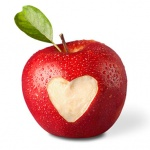 fresh red apple with heart symbol and leaf